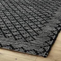 Shop rally leather rug 9'x12'.   Black-on-grey flatweave takes a traditional kilim-like pattern and turns it on its head.  Diamond design is woven on soft cotton using strips of black leather.  An ultra modern update that adds instant edge to any room.