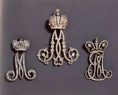 Cyphers for ladies in waiting at the Russian court. These were worn on the left shoulder and suspended from the blue ribbon of the Order of St. Andrew, Russia's highest ranking order. Left to right - Empress Maria Feodorovna - Consort to Tsar Paul 1st (1754-1801), Empress Marie Feodrovna, consort of Alexander III, (right) Empress Elizabeth Alexeivna, Consort of Alexander Ist (1777-1825)