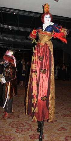 Alice in Wonderland themed Red Queen on Stilts to stop guests in their tracks Tel: 020 3602 9540   UK Entertainment Agency  http://www.calmerkarma.org.uk/Alice-in-Wonderland.htm Manchester, Bristol, Leeds, London, Birmingham