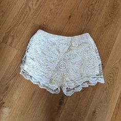 "NWOT beautiful lace shorts NWOT cream lace shorts with lining. Size Small. 13"" from waist. Elastic comfort waistband. Vivid Collection Shorts"