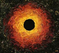 In honor of Earth Day: multi-colored leaves around a hole, by British artist Andy Goldsworthy.