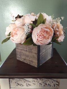 This pretty, peony centerpiece adds a sweet and delicate touch to any setting, while the handmade, wooden planter adds a counterbalancing, rustic charm.  Smaller, like centerpieces can be found at ValleyDusk on Etsy.