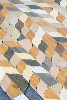 another wood floor design. Marqueterie made of found materials, mostly trashed woods, using a curvy scrap-less pattern cut, by Swiss textile designer Linda Topic.