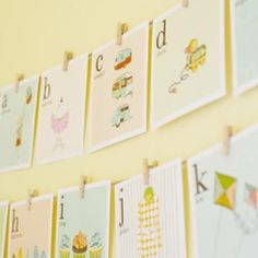 Check out these adorable alphabet printables.  Print them out on cardstock and hang them on a string with some clothespins.  Lovely for a baby shower or nursery decor.  If you really want to go all-out, imagine each one in a little square frame…