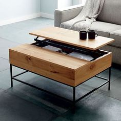 Industrial Storage Coffee Table #westelm aunt Robin loves this because it's sleek and functional
