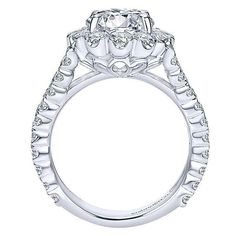 18K White Gold Split Shank Floral Halo Diamond Engagement Ring. This ring features 2.03cttw of round diamonds with a substantial split shank of pave set round d
