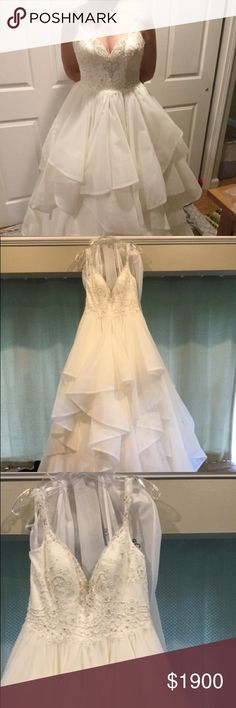 Wedding dress size 12 Selling my wedding dress it's a size 12 no alterations never worn other than in photos. Still with tags. Dresses Wedding