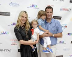 Molly Sims holds an adorable little one while posing with her son Brooks Alan Stuber and husband Scott Stuber