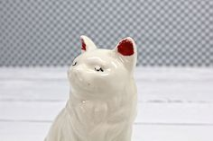 This is a gorgeous Ceramic white cat dated 1944