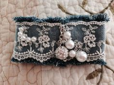 Denim cuff with lace beads and ribbon. por BamaGirlsTrade en Etsy: