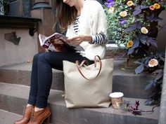 Stash all of your stuff in a sophisticated linen and leather tote.