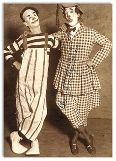 """photo: A """"greasy old clown"""" and a greasy new one. Arthur Borella, the famous """"here's me"""" funmaker of the Sells-Floto circus on the left, and Paul T. Gilbert of the Post staff as he appeared yesterday in the sawdust arena. Borella, who is a college graduate and a musician, receives 600 dollars a week as a producing clown. Paul gave his services free of charge."""