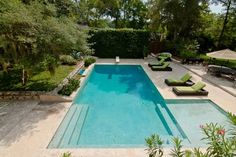 209 Stanley Street: Built in 1969 the Galveston house is listed for $1.2 million. It has a resort-inspired swimming pool with large tanning shelf, diving board, numerous underwater benches for lounging and an infinity waterfall.