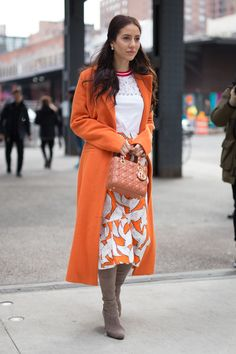 NEW YORK, NY - FEBRUARY 14: Tamara Kalinic is seen attending Tory Burch during New York Fashion Week wearing an orange coat with white and orange bird skirt on February 14, 2017 in New York City. (Photo by Matthew Sperzel/Getty Images) via @AOL_Lifestyle Read more: https://www.aol.com/article/lifestyle/2017/02/15/nyfw-street-style-day-6-new-york-fashion-week/21714646/?a_dgi=aolshare_pinterest#fullscreen