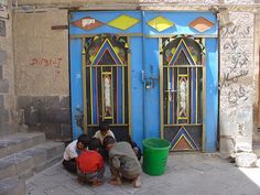 Children playing before a modern iron door in Sanaa by olga_rashida, via Flickr