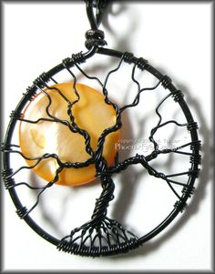 Under A Halloween Moon - Tree of Life Pendant with Orange Pearl Coin Bead in Black Wire Wire Wrapping. $50.00, via Etsy.