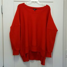 Eileen Fisher Wool Sweater Eileen Fisher Wool Sweater.  Boxy,  long sleeves.  100% merino wool. Orangey red color.  Some pilling, and a few minor pulls,  but plenty of life left in this sweater. Size L. Eileen Fisher Sweaters