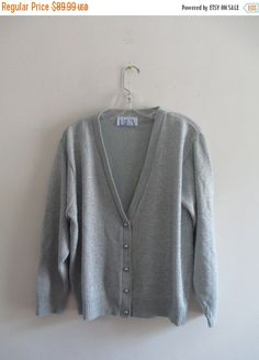 Vintage BFA Classics Silver Metallic Cable Knit Button Down Long Sleeve Knit Winter Cardigan Sweater Sz M/L  This item is used but in great condition. Has no rips, tears, staining, and very slight wear and tear. No sz tag Appropriate for any casual, or evening occasion. Measurements: Bust: 50 Waist: 48 Top to bottom: 24 Sleeve: 21  **Keep in mind measurements are taken laying flat and unstretched** This item comes from ~ONE OF A KIND~ This exclusive vintage fashion line is inspired by the…