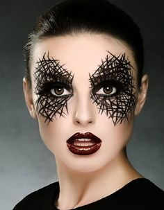 Amp up your Halloween style with sultry spiderweb eye makeup.