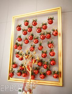 The bells are all hung with clear fishing line, which is attached on the back side of the frame's top edge. You could do the same thing with ornaments or letters - maybe hang mini ornaments in the shape of a Christmas tree? -