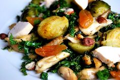 warm kale salad with honey glazed brussels sprouts, haselnuts and apricots