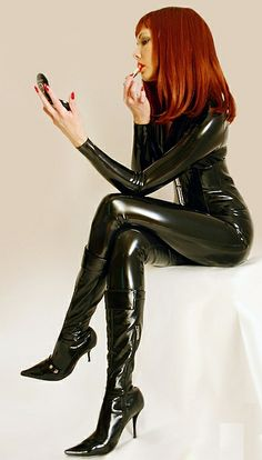 Redheaded model wearing black latex, pretty