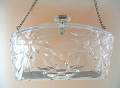 Carved Clear Lucite purse with rhinestones sprinkled here and there.