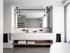 House in Mosman by Corben Architects - two sinks, mirror, cupboards