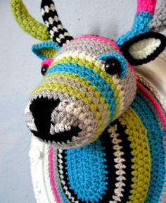 Crochet taxidermy. I really want some of these for the girls' rooms!