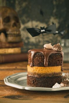 Chocolate and Pumpkin Pie Layer Cake - stacks of fluffy & moist chocolate cake are alternated with creamy maple-infused pumpkin pie nestled on a sweet & crunchy cookie crust.   The perfect dessert for Halloween, Thanksgiving or any fall day you need something sweet.  Click for the RECIPE.