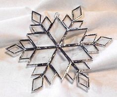 Stained glass snowflake for hanging in my windows! <3
