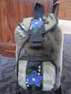 Inuit made/beaded sealskin knapsack by Lorna Atagoyuk