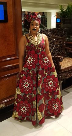 Gorgeous maxi dress with V-neck detail in a traditional African design print. Beautiful colours for day or evening wear. Very flattering shape. FEATURES: no zip; v-neck detail, straps. Full Length: 65 inches. Colour - burgundy, beige and blue. MODEL: 5ft 3inches, size 12 (small) Size