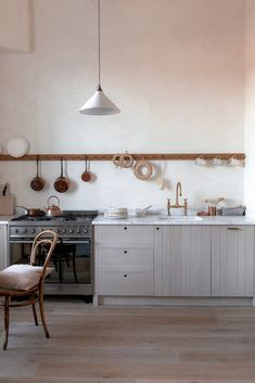 plaster walls wooden kitchen with marble worktop