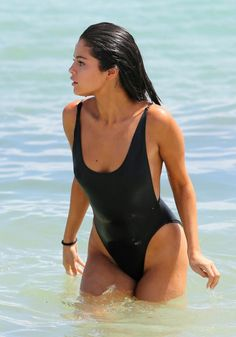 Selena Gomez looks sexy yet classy in a black one-piece swimsuit on the beach in Miami Selena Gomez Bikini, Selena Gomez Looks, Selena Gomez Latest, Selena Gomez Photoshoot, Selena Gomez With Fans, Selena Gomez Pictures, Swimsuits, Bikinis, Swimwear