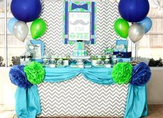 Dessert Table at a Little Man Mustache Bash via Kara's Party Ideas | Kara'sPartyIdeas.com #Mustache #Party #Ideas #Supplies #MustacheCake #desserttable #backdrop #tissuepoms