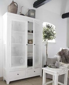 white cabinet, grey sofa, dark beams
