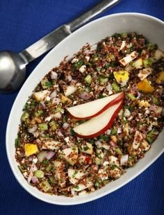 quinoa, pear and feta salad...maybe with a lemon dressing, cranberries and goat cheese? serve with kale sauteed in sesame oil