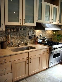too modern but we could do maple cabinets as another option and