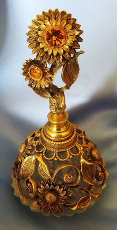 Vintage Ormolu Sun Flowers Perfume Bottle with Amber Tone Glass Jewels