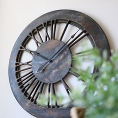 """The """"Old Shaman"""" Skeleton Contemporary Clock is handmade from a single large panel of sustainably sourced pine wood. Its is beautifully hand painted to add uniqueness and character. The most stunning clock face is displaying carefully hand crafted Roman Numerals on a wooden frame and you can see the wall between the numbers. With a total diameter of 100 cm and its unique contemporary design, the Old Shaman will look fantastic in all interiors"""