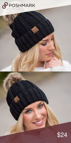 Black Knitted Pom Beanie This chic, simple black knit beanie is perfect for any chilly day. With a soft knit, blanket lined inside, stylish faux fur pom pom and signature suede CC label you'll be stylish and warm all season long   Color: Black  75% ACRYLIC 25% POLYESTER  Blanket Lined  Faux Fur Pom Pom  CUSTOMER REVIEWS C.C Accessories Hats
