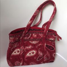 Vera Bradley red paisley purse. This is a red paisley purse in great condition. It has several pockets as seen by the photos. Vera Bradley Bags
