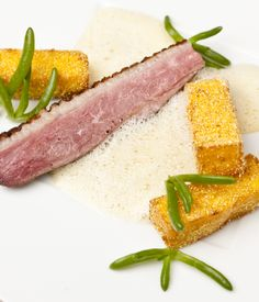 This playful take on duck a L'orange from Pascal Aussignac contains a delightful orange vinaigrette and aromatic polenta fries.