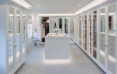 The lighting is a key elements in this glamorous walk-in closet.