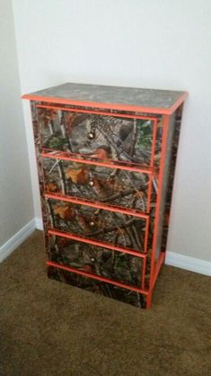 Camoflauge Painted Dressers   Our daughter's dresser daddy painted the orange she's gonna love it