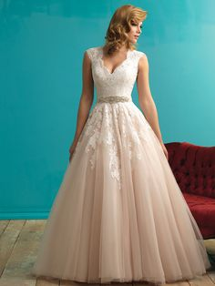 Allure 9272 Transparent lace composes the back and cap sleeves on this ethereal ballgown. Accessorize with a sash or let the lace speak for itself.