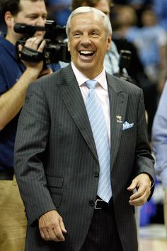 Roy Williams, Head Coach of the North Carolina Tarheels Men's Basketball Team - was born in Marion (just outside of Asheville) and raised in Asheville.  He graduated from TC Roberson High and played at UNC Chapel Hill.  Williams' first coaching job was at Charles D Owen High in Black Mountain, NC.  Williams is now one of the most successful coaches in college basketball history.