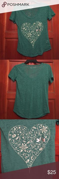 """Teal/blue shirt Teal/blue kids t-shirt. Has a heart with flowers in it and two silver birds as well. 55% cotton and 45% polyester. From Selena Gomez's """"Dream Out Loud"""" collection Selena Gomez Tops Tees - Short Sleeve"""
