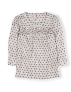 The floral spots on this top and the soft gray color would be great for spring!